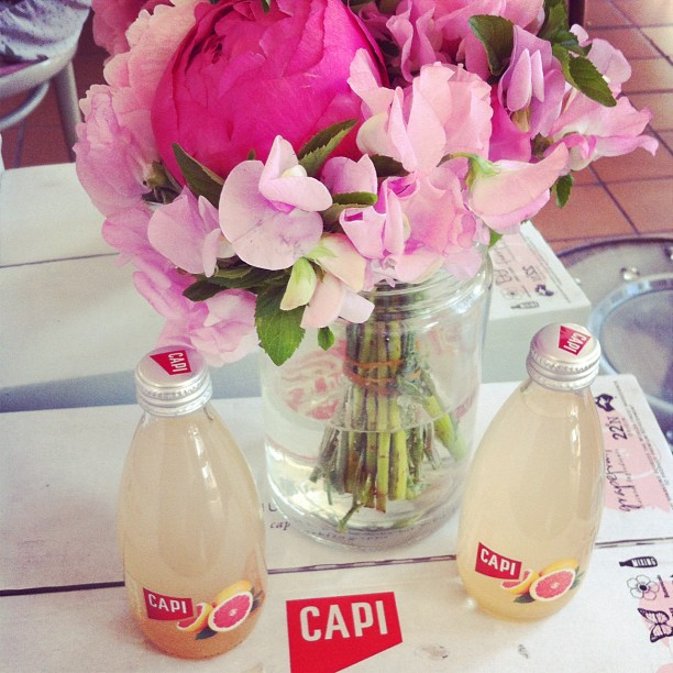 Cute Capi soft drinks have just been delivered for a special event we are having - they look too perfect with our gorgeous pink peonies from Fleur in Armadale!