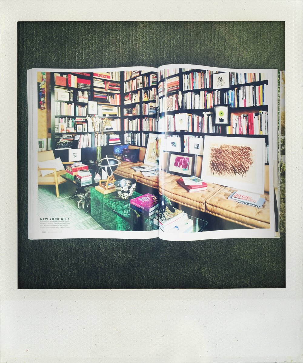 Now this is a library!  Cy Twombly and Willem de Kooning casually adorn this well-stocked media room