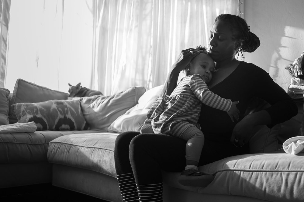 Mom and toddler daughter hugging on couch - Slice of Love Photography - Bay Area Family Photographer