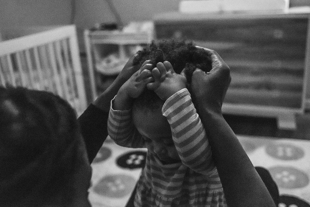 Child getting her hair put into a ponytail - Slice of Love Photography - Bay Area Family Photographer