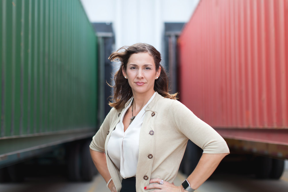 Another example of a headshot for a corporate attorney, however, this was taken specifically for an editorial piece that was profiling attorneys in various discourses. This was taken at a container loading dock for a logistics company and we wanted to show a serious, strong and confident look for this particular image.