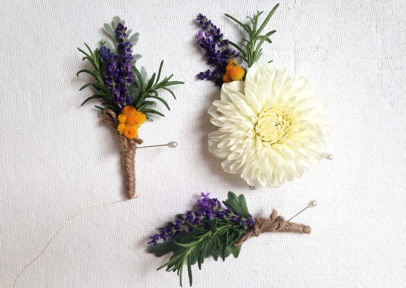 Groom's and grromsmens' boutonnieres and corsage. Lavender, rosemary, dahlia and strawflower.