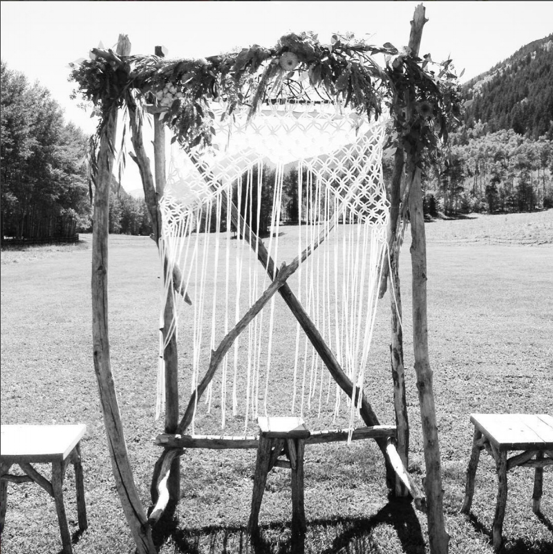 Garland on groom-made arbor-T-Lazy 7 Ranch, Aspen.