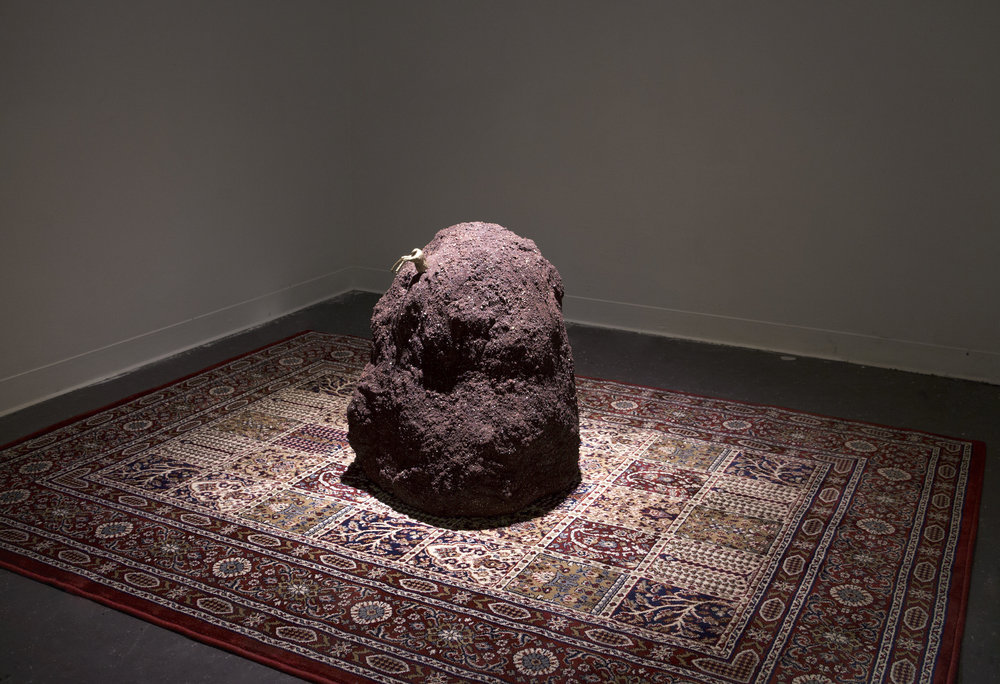 "Incrustation of a Deer: 35x67x91"", lava rocks, glitter, rug, plastic deer, 2014."
