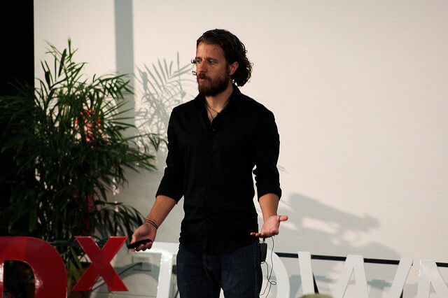 Jeremy Goldberg delivering his moving TEDx Talk on stage at TEDxTownsville