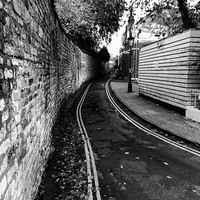 #lincoln #city #ancient #road #double #yellow #lines #light #evening #lead #instagood #monochrome #power #depth