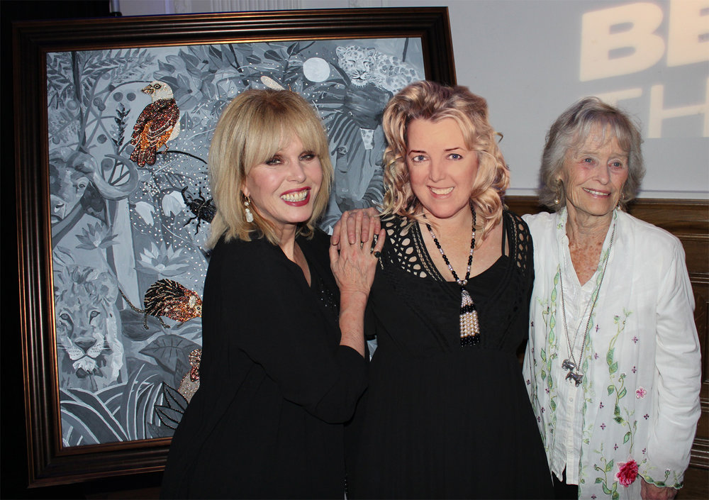 """'THE UNKNOWN' Swarovski crystals, rhinestones, acrylic & oil paint on canvas. 51 x 51 inches (130cm x 130cm). With Joanna Lumley and Virginia McKenna of The Born Free Foundation.  """"The Unknown"""" is an allegorical painting about power disparities. It focuses on the """"Little Five"""": Leopard Tortoise, Elephant Shrew, Rhino Beetle, Buffalo Weaver and Ant Lion, as opposed to the usual """"Big Five"""" who, this time, are hidden in the Rousseau inspired background."""