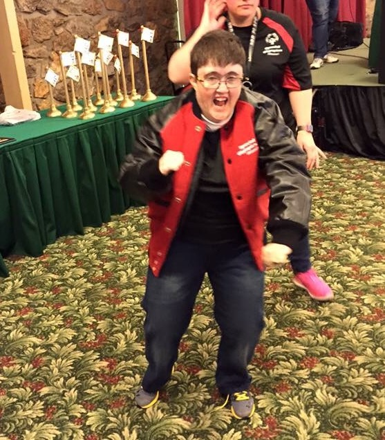 SOMO athlete Beth Brokamp of Columbia celebrates after receiving her letter jacket for raising $5,000 to go toward the Training for Life Campus.