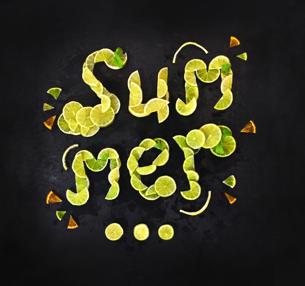 'Summer' - Food design & typography.  Type designed to promote summer on social media using lemon, lime and orange slices with a touch of mint to represent gin & tonic.
