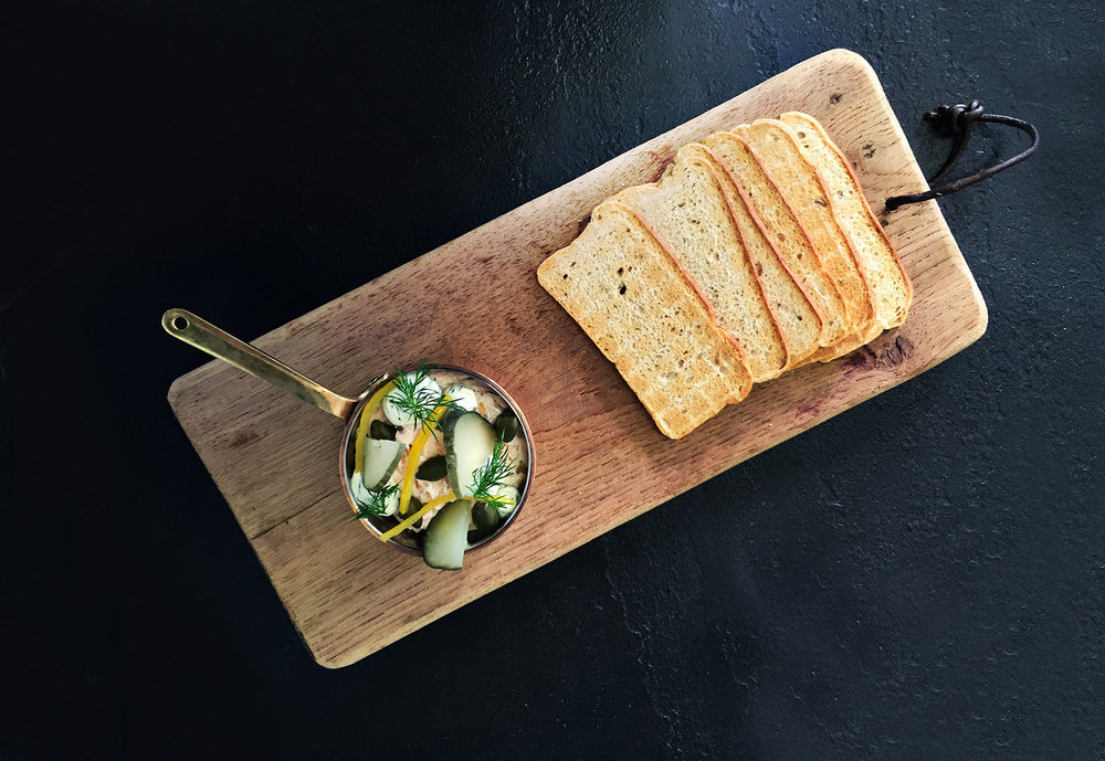Salmon-Pate-Served-With-Melba-Toast,-Capers,-Gerkins,-Preserved-Lemon-And-A-Dill-Crème-Fraiche.jpg