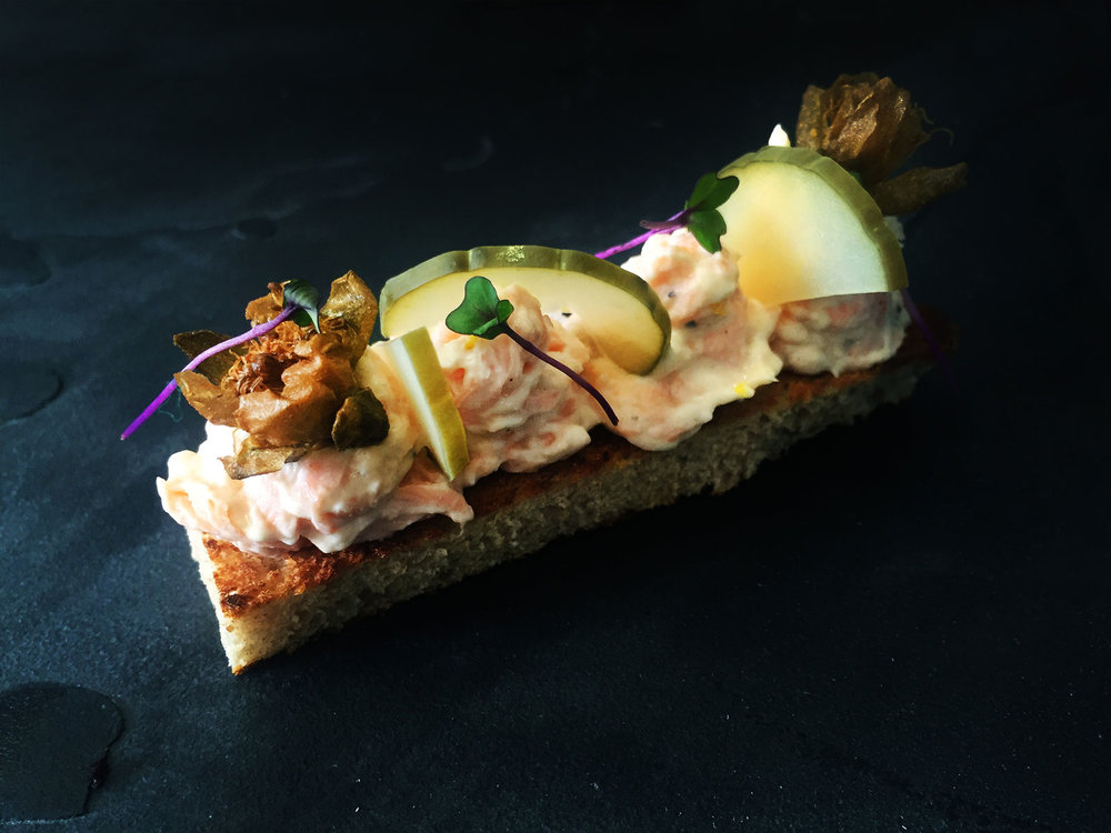 Salmon-pate-served-with-toasted-flatbreads,-deep-fried-capers,-chopped-gerkins,-preserved-lemon-and-a-dill-crème-fraiche.jpg