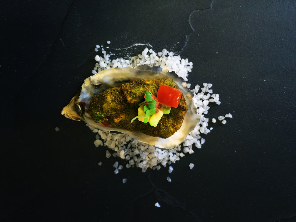 Oyster-deep-fried-with-herb-panko-crumbs-served-on-tomato-and-avocado-salsa.jpg