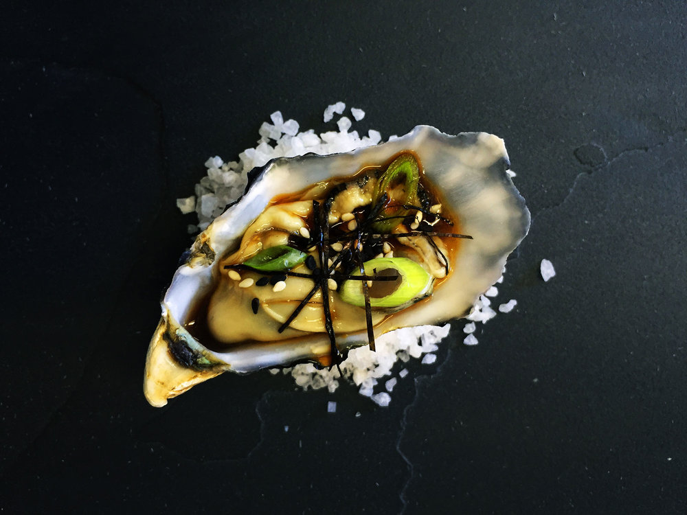 Oyster-with-Asian-sesame-citrus-dressing,-nori-strips,-sliced-spring-onions-and-toasted-sesame-seeds.jpg