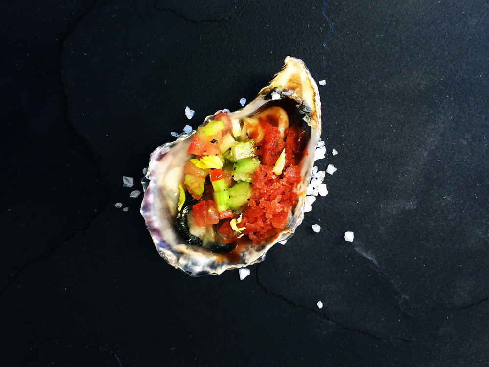 Oyster-with-Bloody-Mary-granite,-celery-salsa-and-a-dash-of-Tabasco.jpg