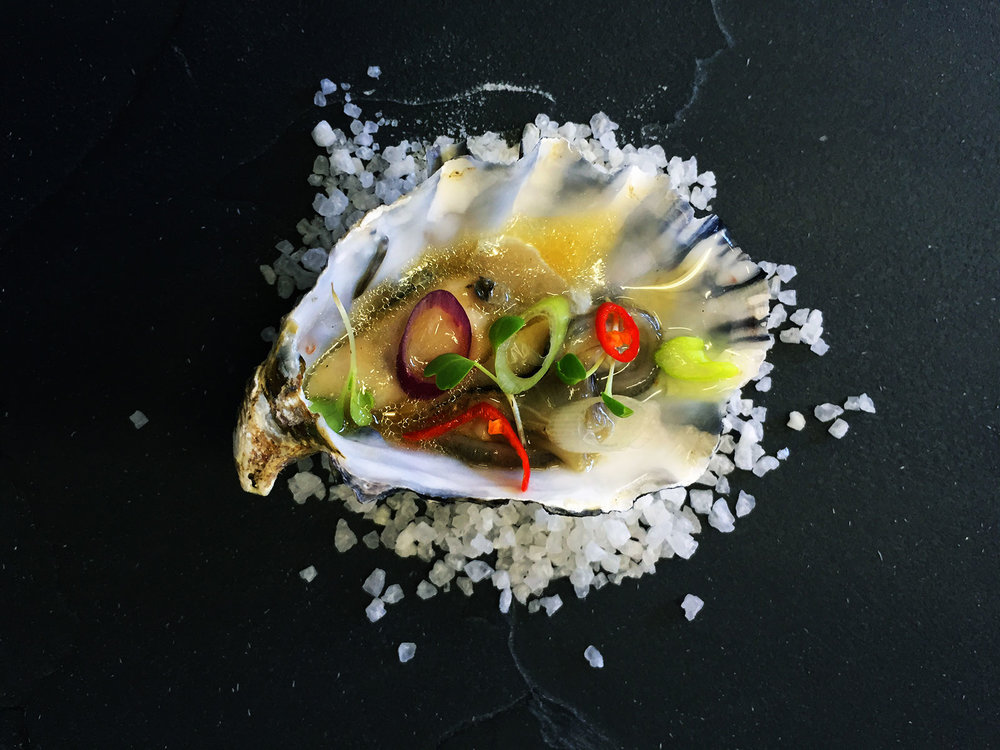 Oyster-with-ginger-and-rice-wine-vinaigrette,-chilli,-coriander-and-fresh-spring-onion.jpg