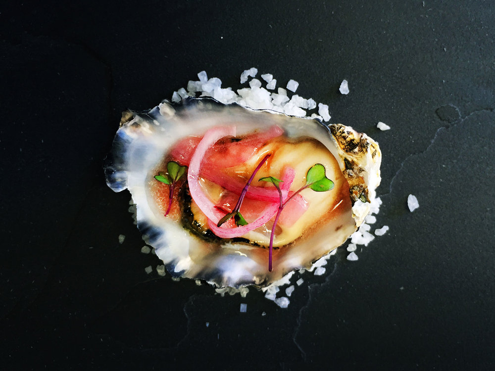 Oyster-with-pickled-red-onion,-parsley-and-red-wine-vinaigrette.jpg