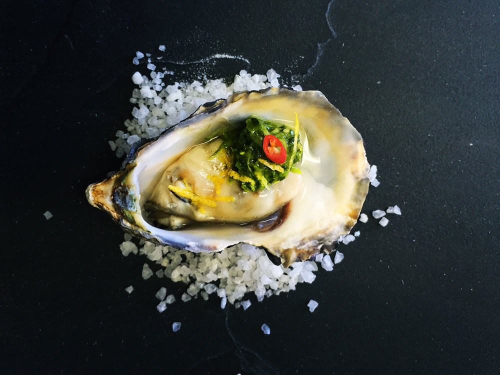 Oyster-with-spicy-chimichurri,-coriander-cress-and-lemon-zest.jpg