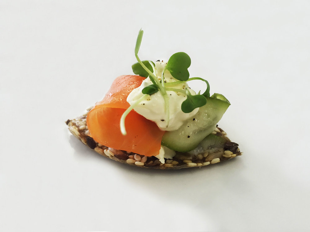 salmon-trout-on-seeded-cracker-with-pickled-cucumber-cream-cheese-and-watercress.jpg