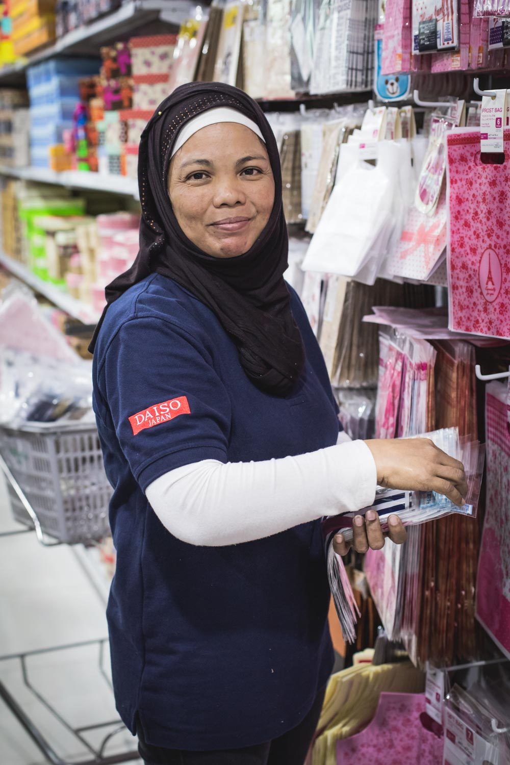 "Mariam (Maria)    Shop attendant   ""Three years ago I was lost, I was a naughty girl, I didn't have happiness. But then I found Islam and, by converting, I became a different person. I found my place. I was afraid that my family and friends would not accept me, but they saw the change in me and they supported me. They respect my fasting and it doesn't even feel hard.""   From Philippines 7 years in Dubai"