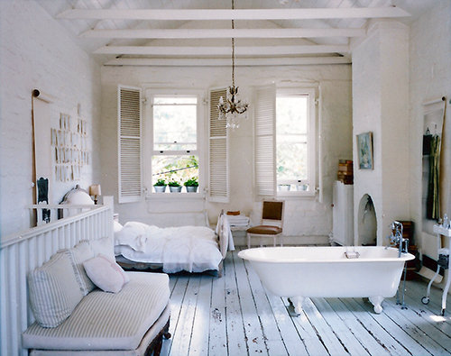 Cozy, dimly-lit bedrooms are so inviting, so adding a clawfoot or stand  alone tub can only enhance the relaxed vibe. Think I need to do this  someday.