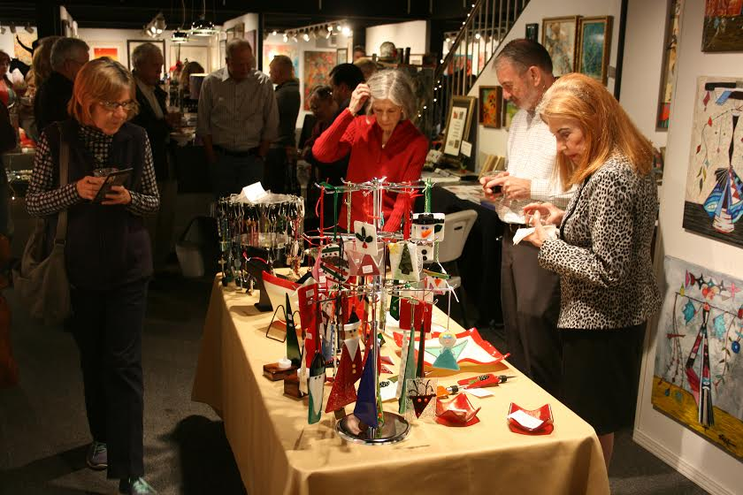 Jewelry artists' wonderful holiday/Christmas ornaments and glassware are on display.
