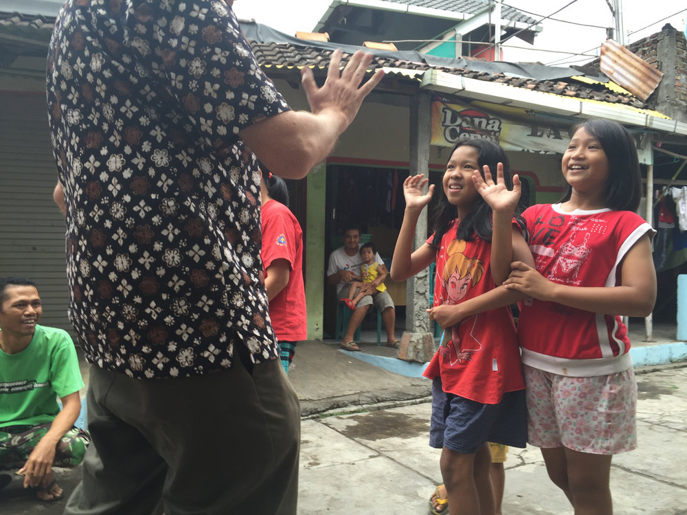 My cousin Greg, a friendly giant among Indonesian school children in his Yogyakarta neighborhood