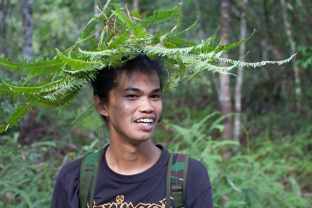 Our guide, Den, demonstrated a rain hat made of ferns that he had learned to make by watching orangutans.