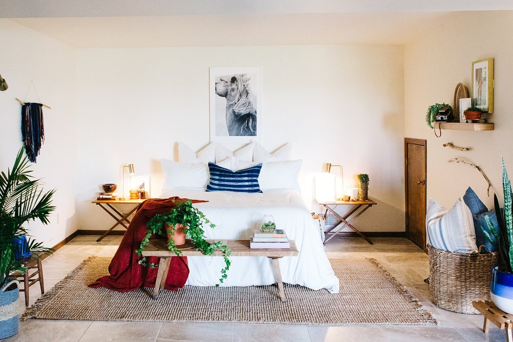 After.  The clean white lines, weathered furniture, plethora of comfy pillows, pops of color and pattern, plants, art, and curated clutter all collectively merge Scandinavian and Bohemian styles, turning it into a welcoming space that feels like home.
