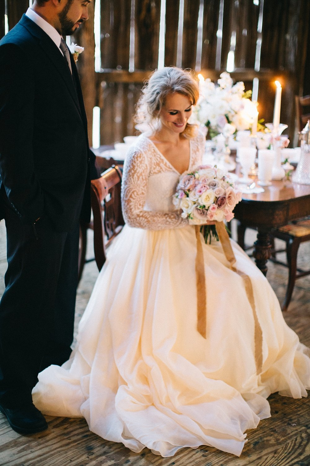 WOW.  This DRESS!! We loved everything about this draped flowing skirt in a delicate peachy pink organza. This light and dreamy dress is paired with a more contemporary cut long sleeved lace top. Lace & Liberty designs unique wedding separates that you can combine to really create a spectacular gown.