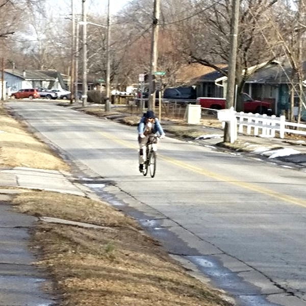 Lone Cyclist on Shawnee Road in Rosedale