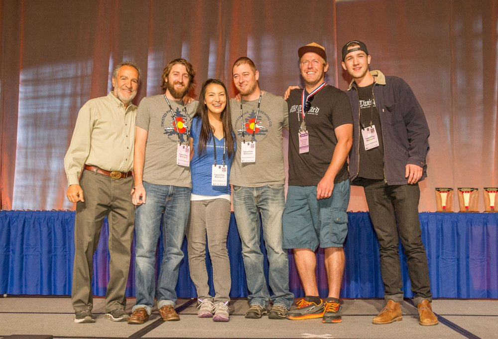 Photo © 2017 Jason E. Kaplan   Founder of the Brewers Association Charlie Papazian, left, with the Twisted Pine Brewing staff - Matt Crosson, Hannah Olbrich, Gabe Toth, Nick Wilson, and Kevin Mayer - at the Great American Beer Festival awards ceremony