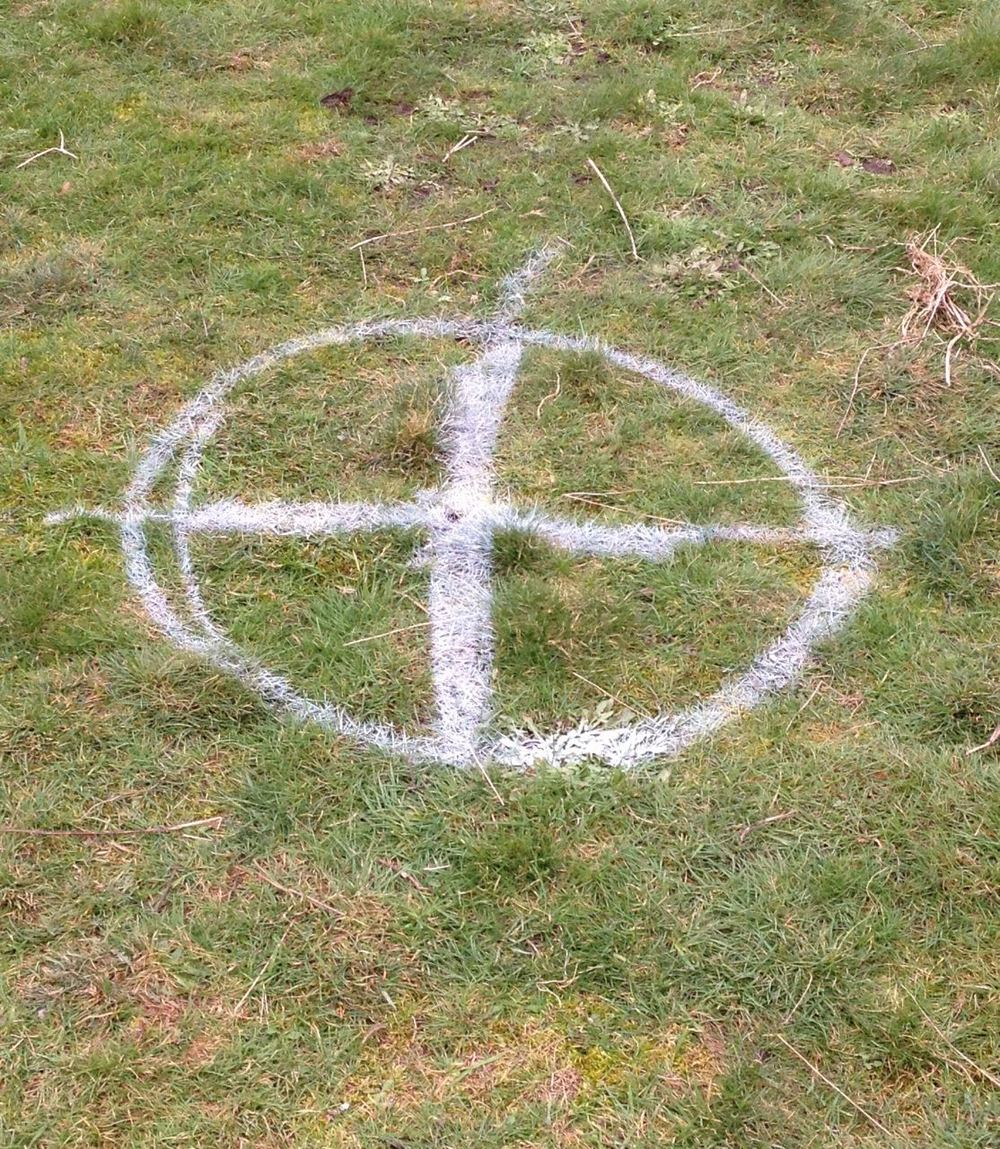 An enthusiastic marking of the centre of the grass circle, which won't become a helicopter landing pad or, hopefully, attract aliens.