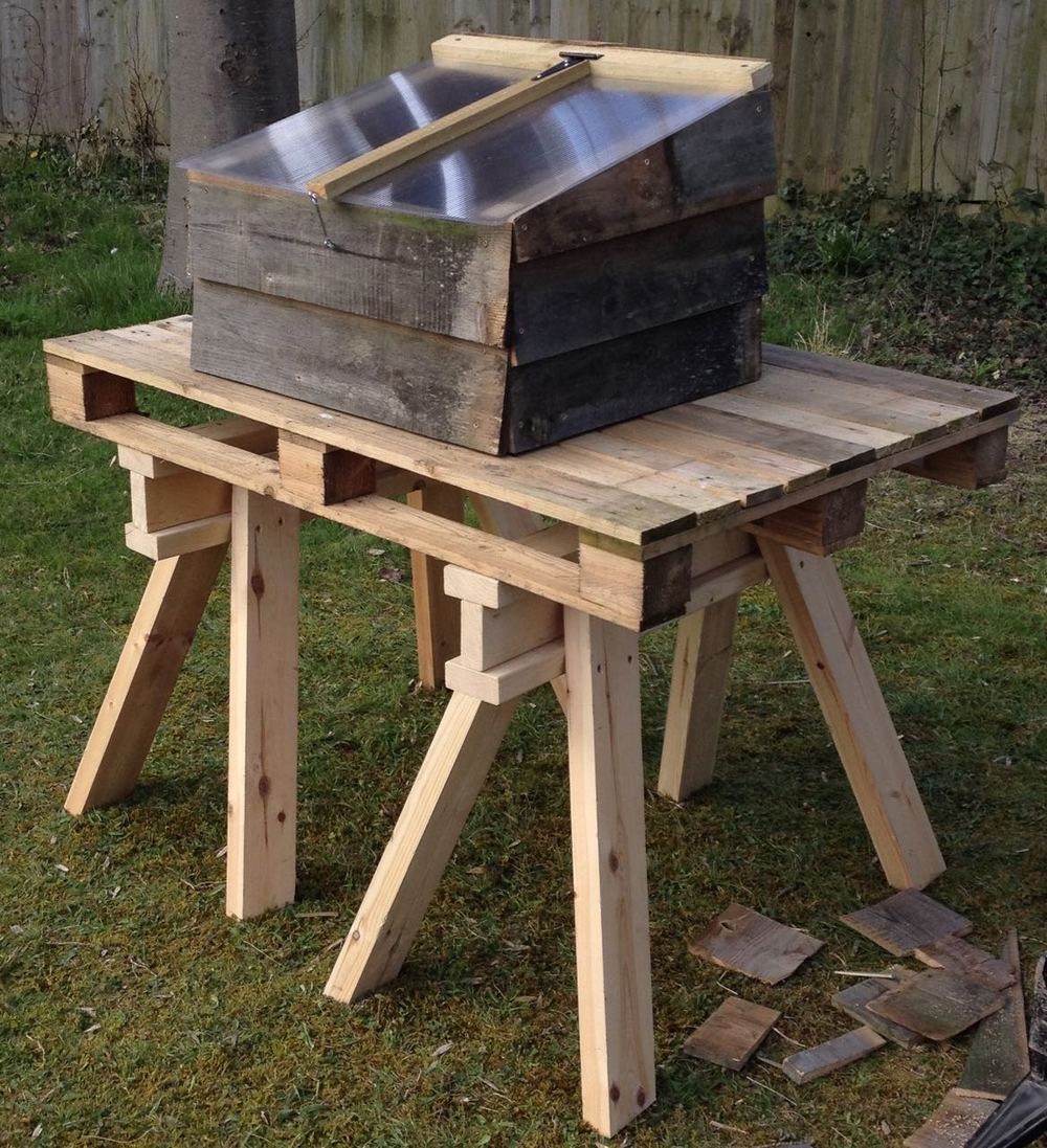 New cold frame on our new workbench - an old pallet on two trestles, made of waste wood from a skip. The cold frame was made from waste wood and some left-over polycarbonate.