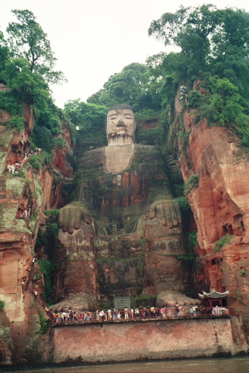 Leshan Giant Buddha, at 237 feet it is far and away the Buddha statue in the world. It is so large that I could sit on its small toenail. Built during the Tang Dynasty (started 711 and finished 803.) It is carved out of a cliff face at the junction of two merging rivers.