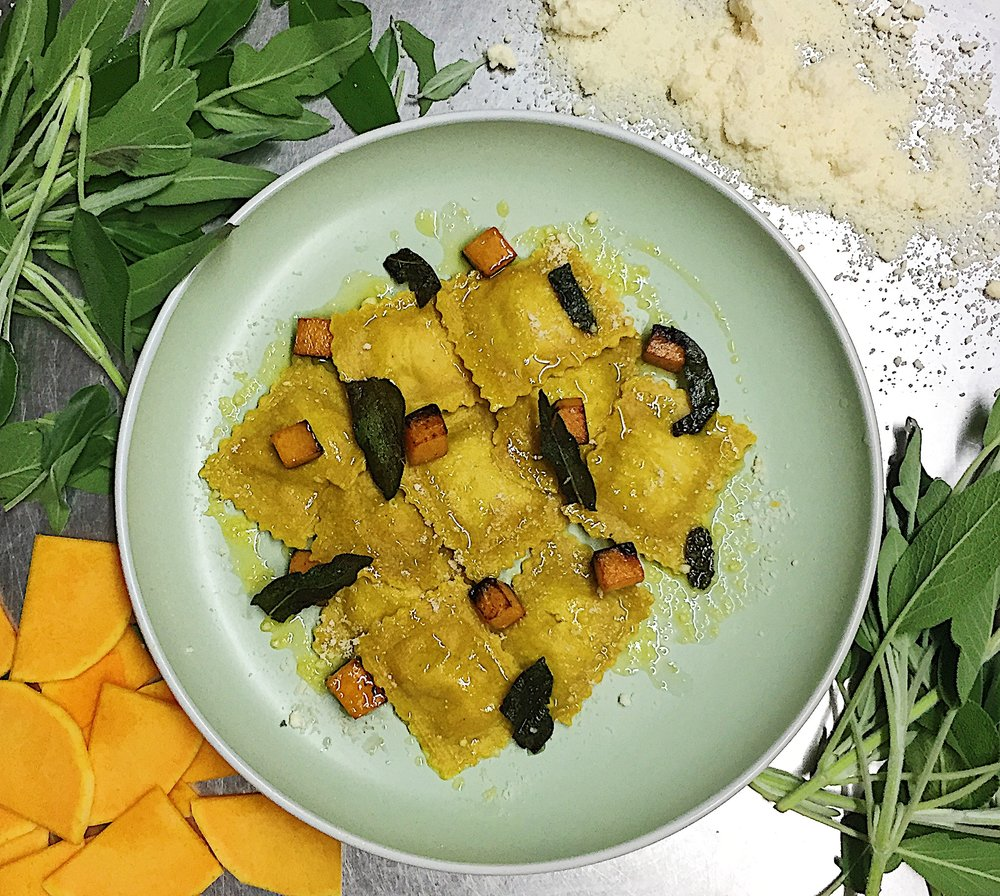 Butternut Squash and sage ravioli   Roast butternut squash and roast sweet spanish onions are mixed with fresh and roasted sage for a sweet and warming filling.  Served here with sage butter sauce, crispy sage and roast butternut cubes