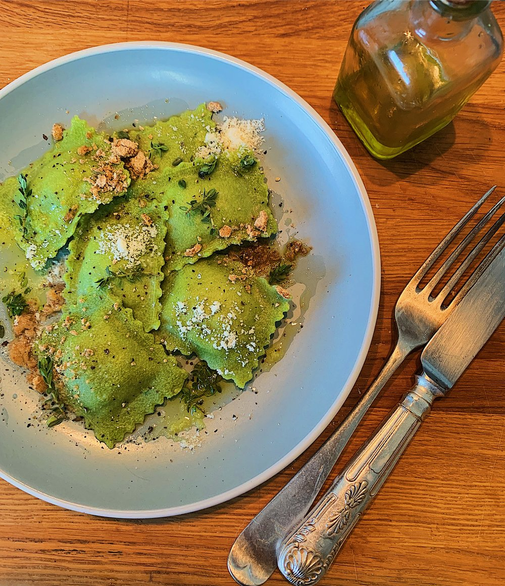 Caramelised Pear and Goat's Cheese Ravioli   Pears are slowly caramelised with thyme, de glazed in their own liquid then combined with a salty local goats cheese for our second most popular filling.  Stained green with spinach and served here with thyme live oil, crushed walnuts, parmesan and black pepper.