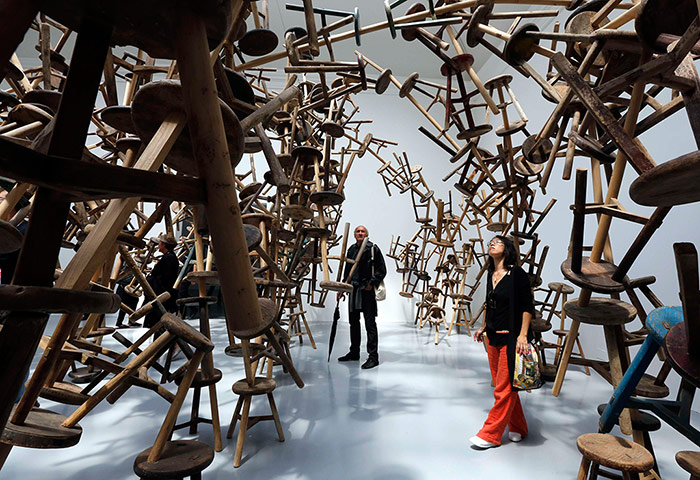 "Visitors looks at installation "" Bang "" by   Chinese artist   Ai Wei Wei at the 55th La Biennale of Venice May 29, 2013."