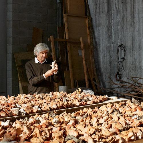 Artist Guiseppe Penone working on one of his sculptures at his studio in Turin, Italy.