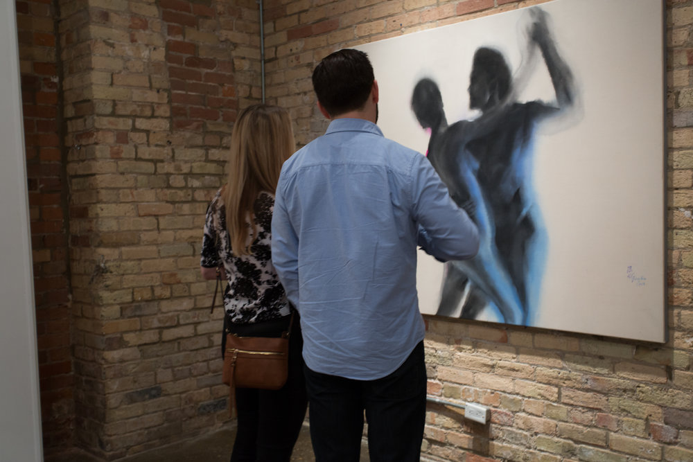 "Taking a closer look at Feng Bin's artworks at Artlink Canada's ""East Meets West"" Exhibition Opening Gala in Toronto, Canada."