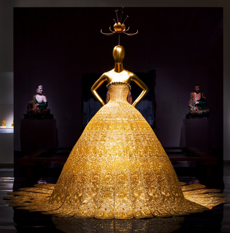 "Silk couture dress by Chinese designer Guo Pei became one of the centre pieces of the ""China Through the Looking Glass"" Exhibition at the Metropolitan Museum of Art."