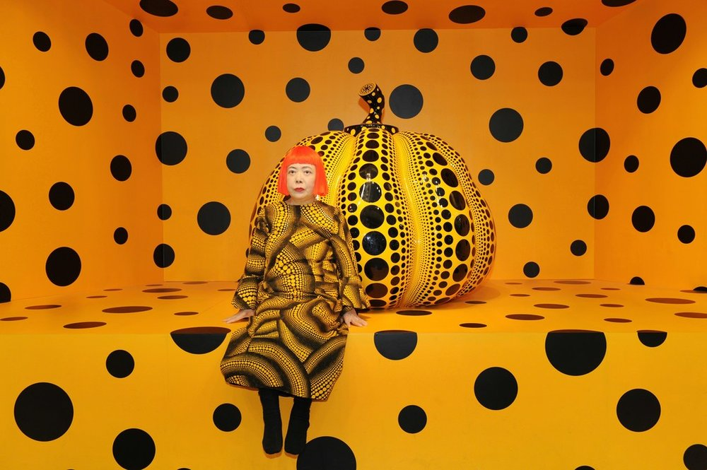 Japanese artist Yayoi Kusuma photographed beside one of her iconic pumpkin sculptures.