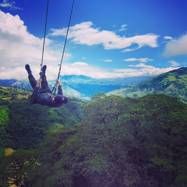 Sean Ronayne swinging fearlessly over the Andes in the Casa del Arbol in Ecuador.