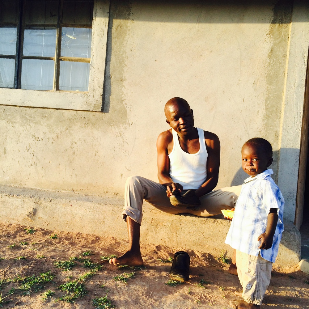 Peter and his son Eduardo outside of their home in Matoso.  Matoso is a HOTBED of joy and family.