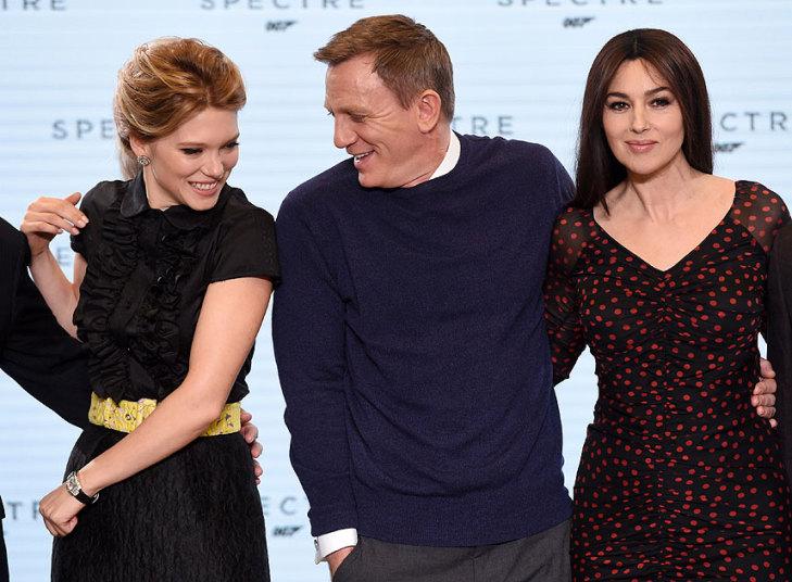 Cheeky: Daniel Craig with Spectre Bond girls Lea Seydoux (L) and Monica Bellucci (R)