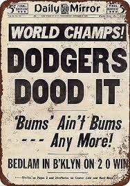 Headlines the day after the Brooklyn Dodgers won their first World Series in 1955.