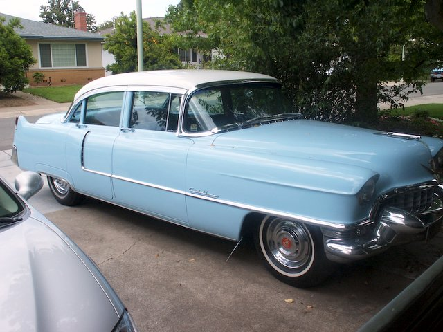 A father bequeaths a 1955 powder-blue Cadillac to his son.