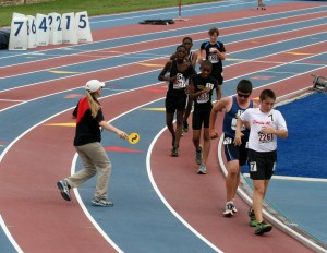 After I graduated from college, I studied to get certified as a race walk judge. Here I am judging a youth meet and showing one of the walkers a caution for being close to breaking the straight knee rule