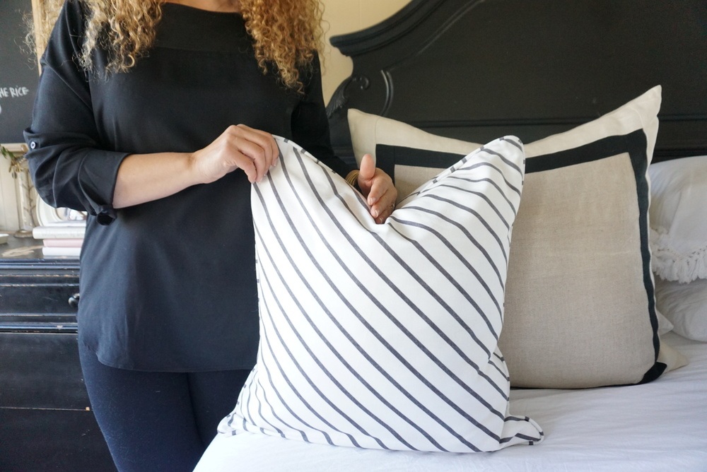 Getting rid of pillows stuffed with polyphore and replacing them with down filled pillows will instantly make your home feel cozy. Not only are they more comfortable, they also last longer and typically come with removable pillow covers that can be washed or changed when you want to try something new.