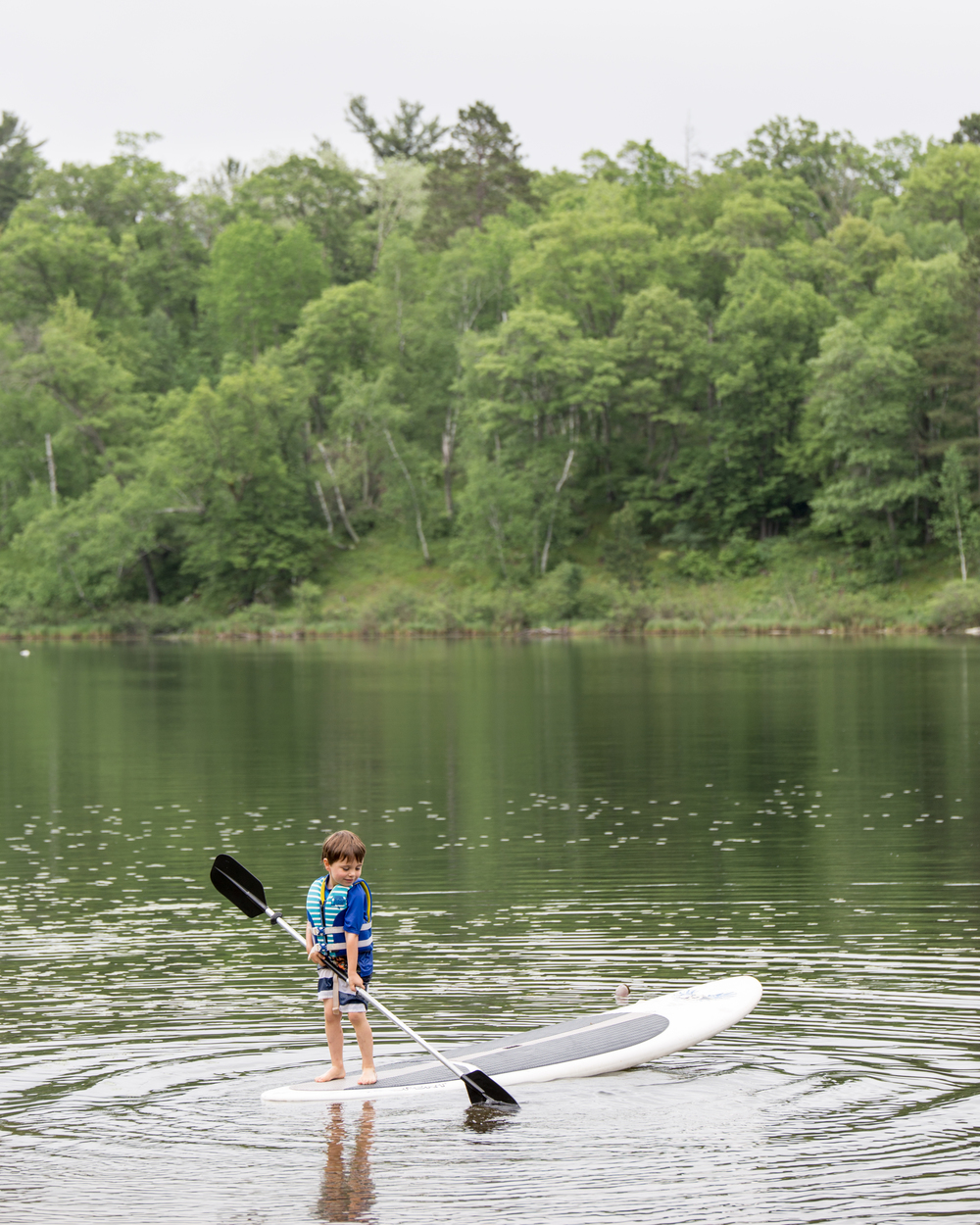 It was hilarious to watch Arlo jump on a SUP for the first time and cruise away like he had been doing it for years. The beach area also had a basketball hoop, some swings, a fire circle and even a bath house with fresh towels, running water and a toilet.