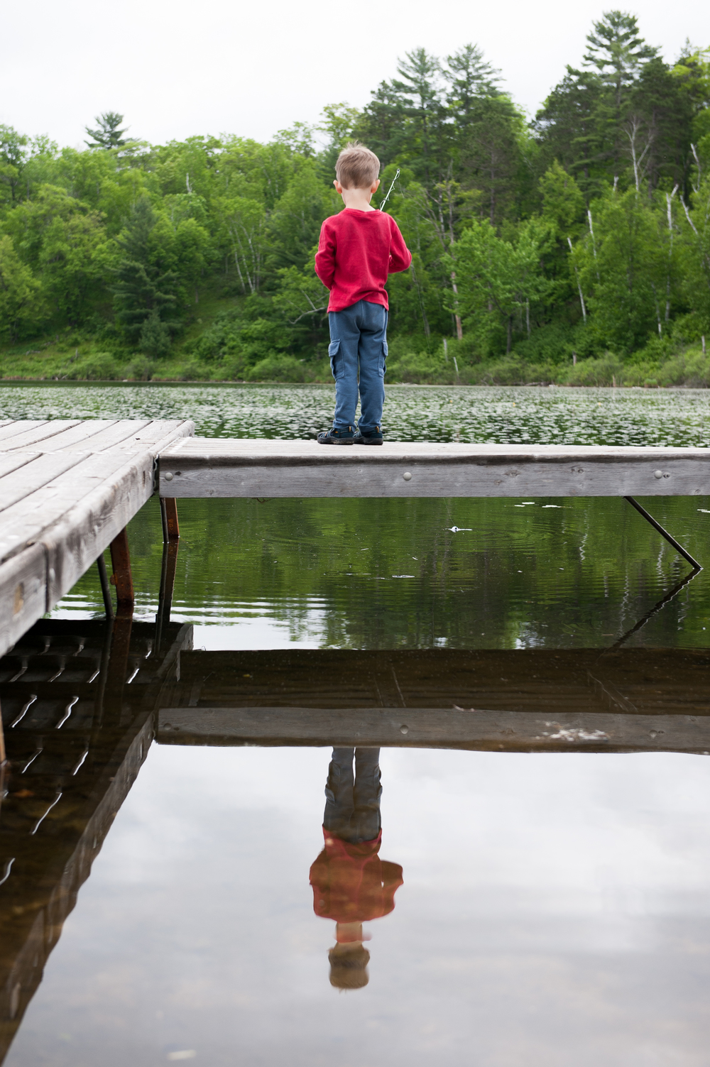Boy on Dock with mirror image.jpg